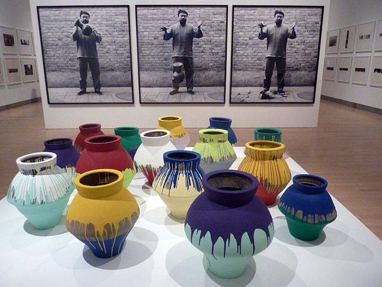 Ai Weiwei: Installation view of Top: Dropping a Han Dynasty Urn, 1995. Triptych of Lambda prints, each: 75 3/8 x 70 7/8 in. (191.5 x 180 cm). Bottom: Colored Vases, 2007‒10. Han Dynasty vases and industrial paint, dimensions variable.